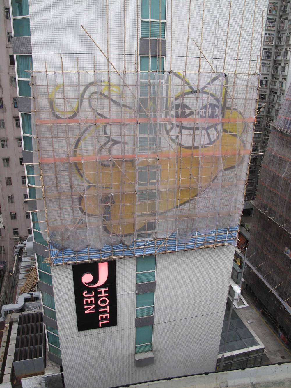 Wall painting in progress by M. Chat at Hotel Jen Hong Kong.jpg
