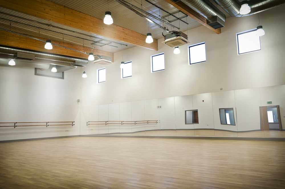 Dance studio with fully sprung flooring, sound system, mirrors and ballet bars