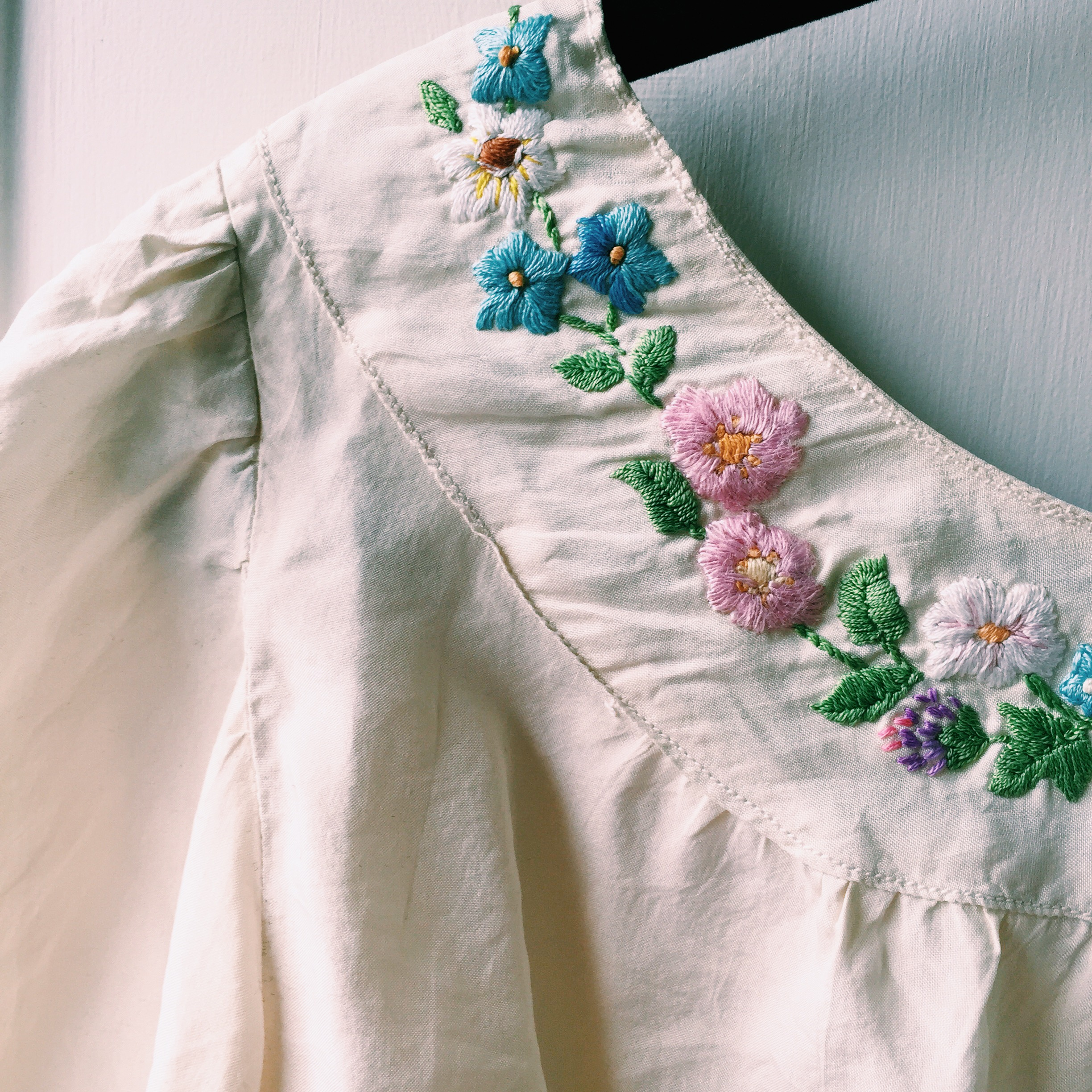 A vintage hand-embroidered blouse from the 1950s