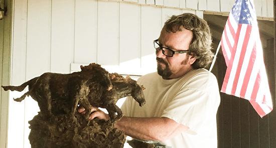 Jerry Vaughn sculpting at his home study.