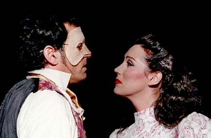 "Laurence Paxton is the phantom and Melissa Short is Christine in the Diamond Head Theatre production of ""Phantom."""