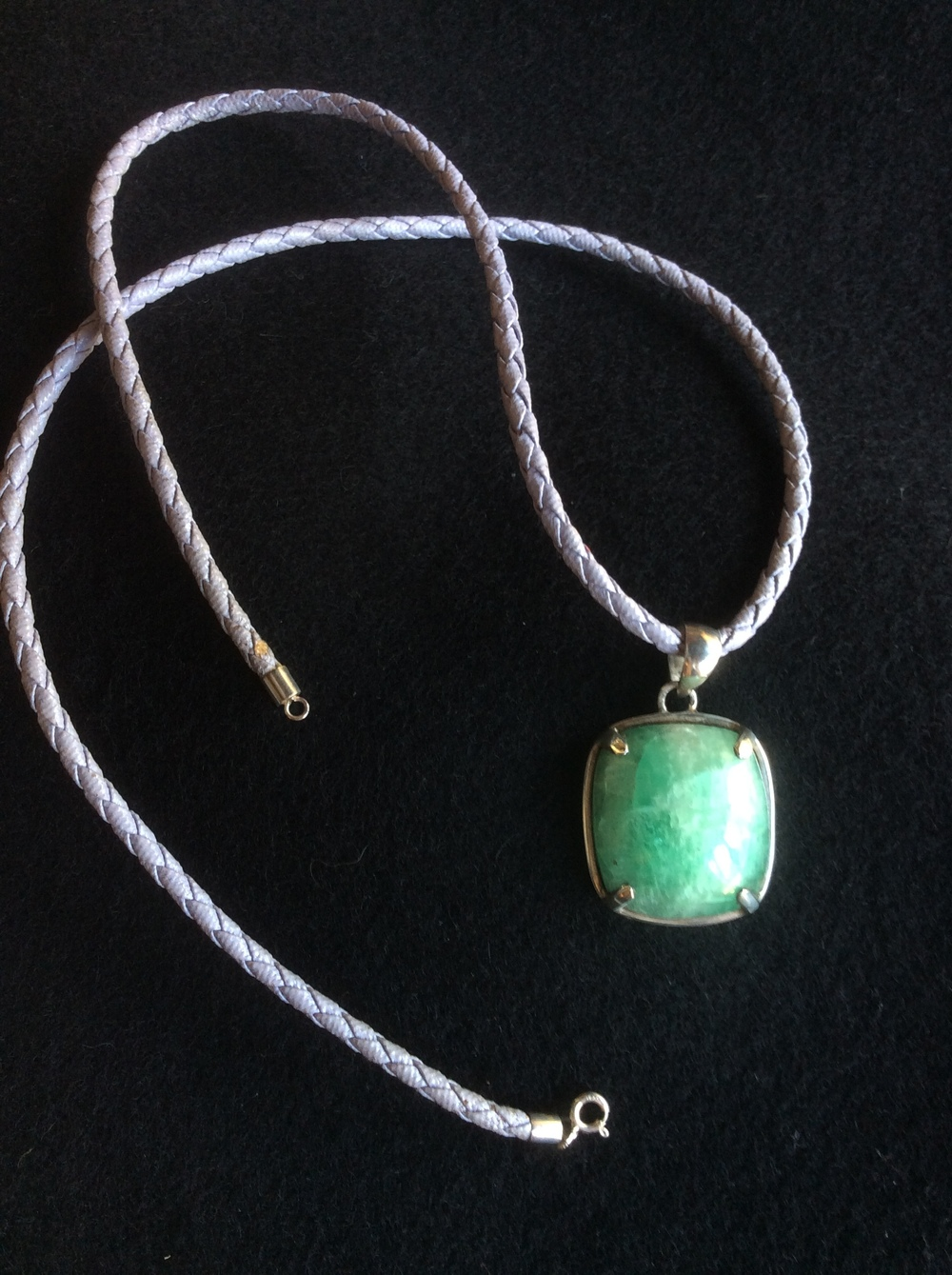 emerald pendant with leather chain