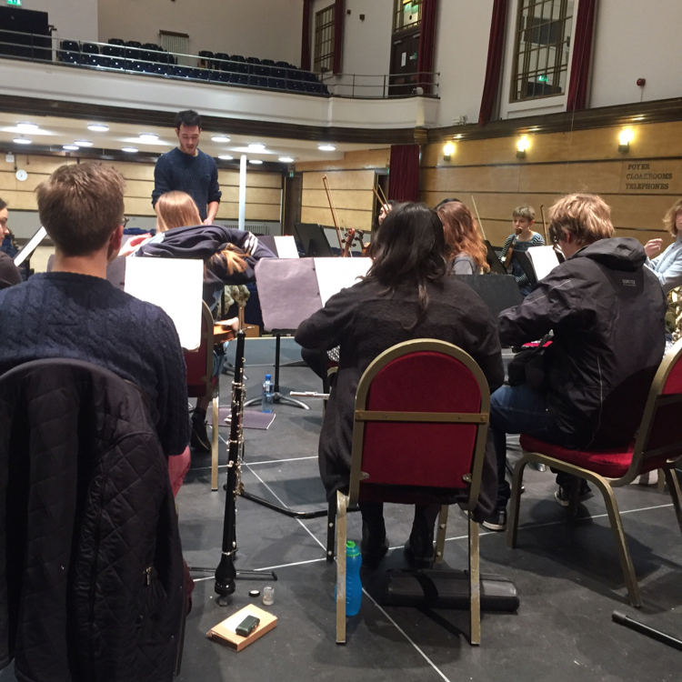 An action shot of our conductor and orchestra in action.