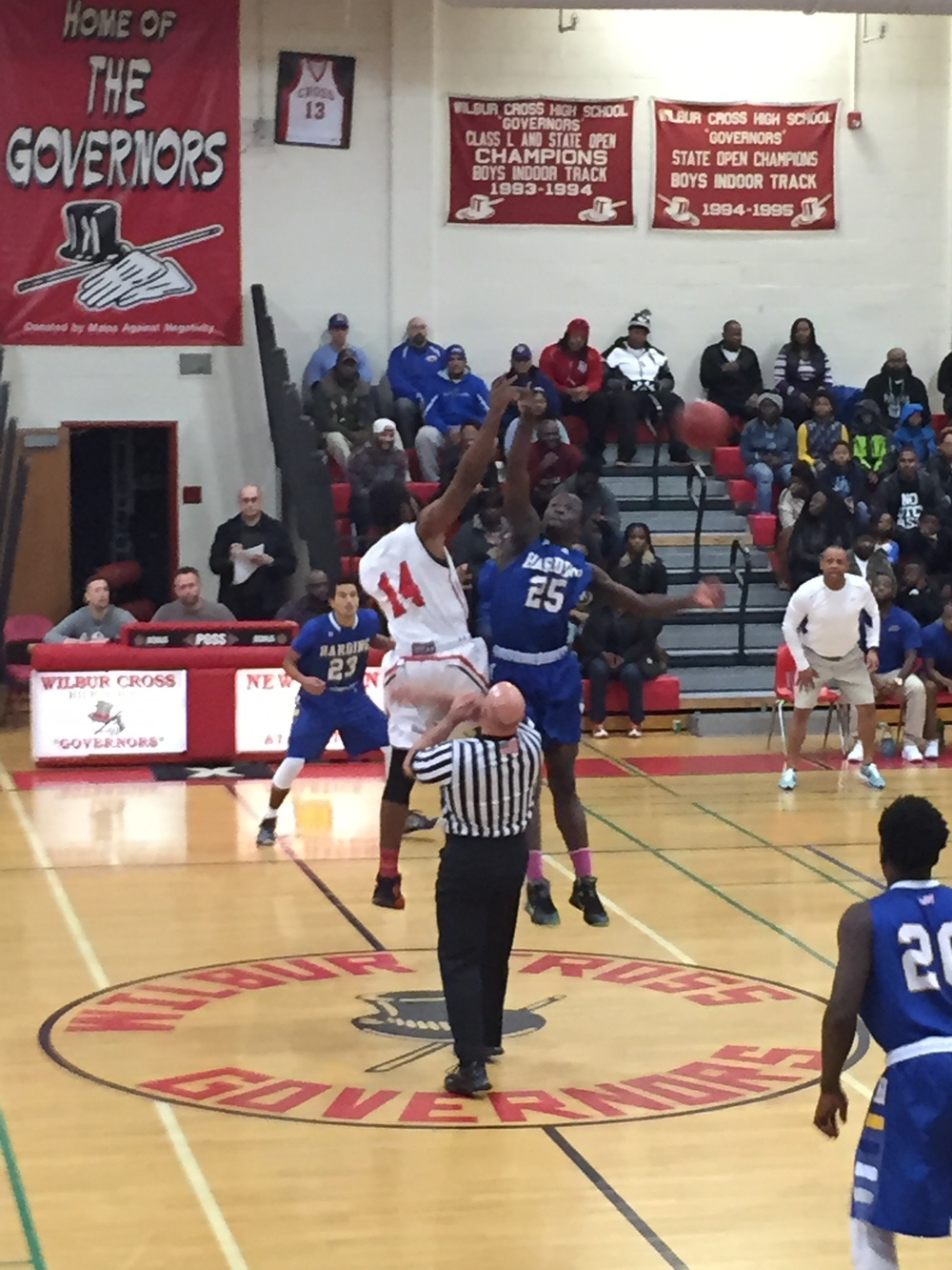 Tip off between Harding and Wilbur Cross. Provided by: CTHoopsNews