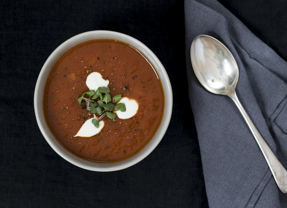 Roasted tomato soup with creme fraiche and baby radish leaves.jpg