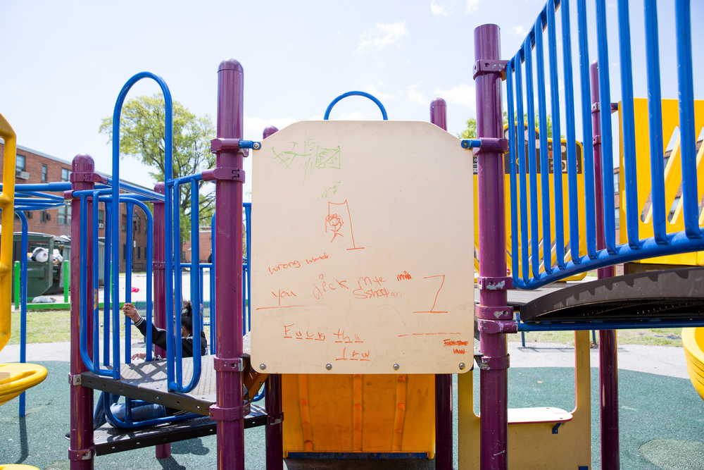 Crude grafitti is seen scrawled on a children's playground set near South Caroline and East Pratt in Baltimore, Maryland.