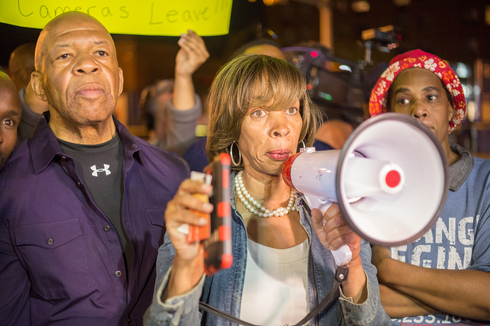 Maryland State Senator Catherine Pugh warns a group of people to go home prior to the curfew 10:00PM