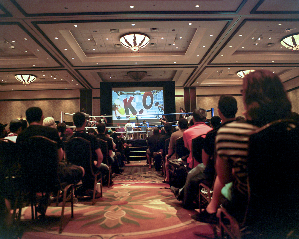 "The crowd at the Community Effort Orlando (CEO) tournament watches as a match between Maryland favorite IGT Unkown and New York favorite Christopher ""ChrisG"" Gonzalez draws to a close."