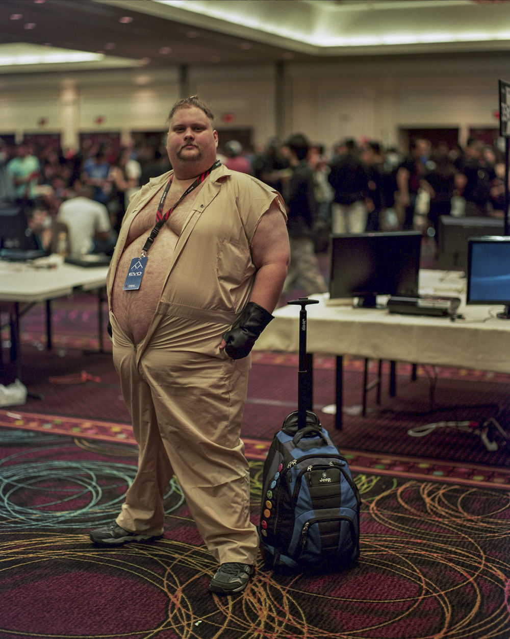 A spectator dresses up as his favorite character, Rufus, from Street Fighter, to watch the festivities of the EVO gaming tournament unfold at the Paris Hotel, in Las Vegas, Nevada