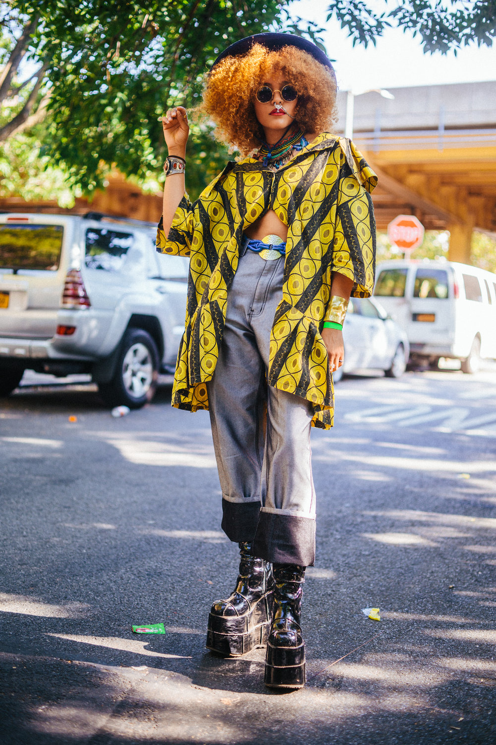 "Quintessa, 19. ""I was going for some 70s energy,  some African print, silhouette just a little masculine, mostly comfortable. I'm here for Bad Brains."""