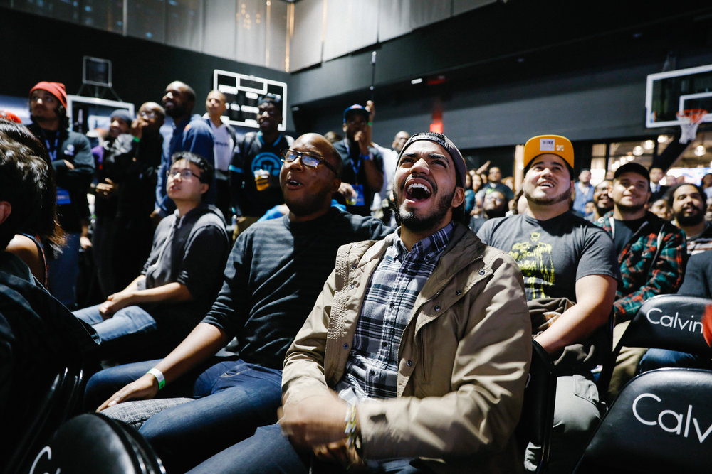 The crowd in the Street Fighter room celebrate after a major upset featuring a top player.