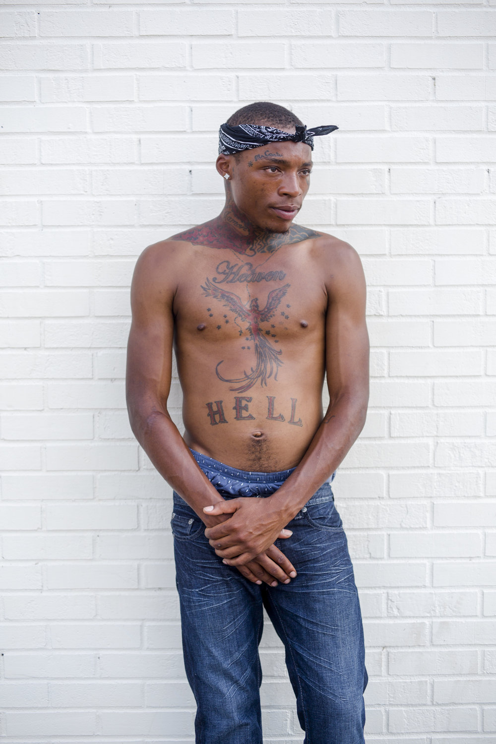 A Ferguson resident photographed against the wall of an approved assembly area he has taken to manning and keeping stocked with supplies and refreshments to aid the protesters, police, clergy and police along West Florissant avenue. Aug. 22, 2014.