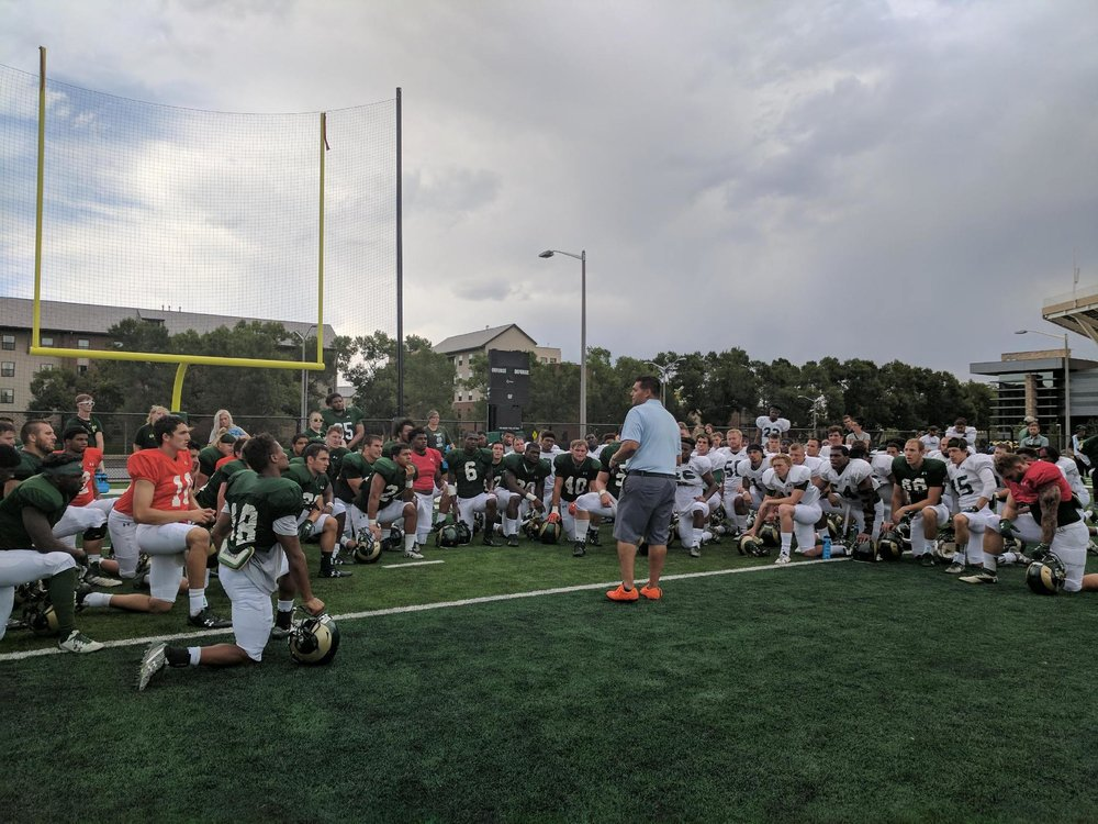Reza speaking to CSU Football.jpg