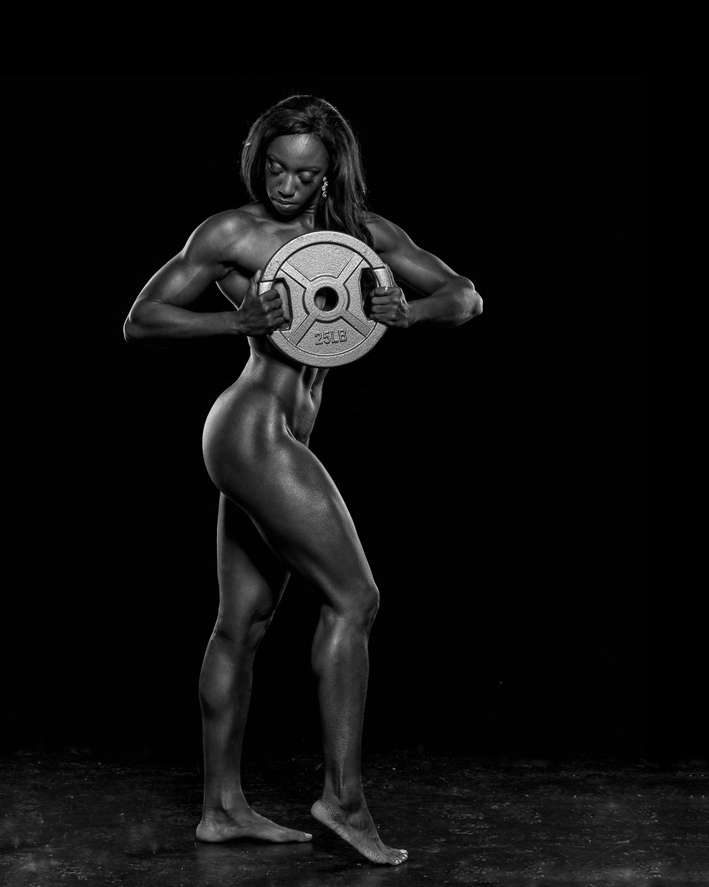 woman-bodybuilder-holding-weight-naked (1).jpg