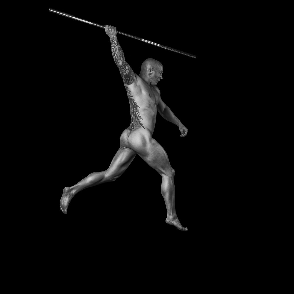 nude-male-fitness-jumping-with-bar
