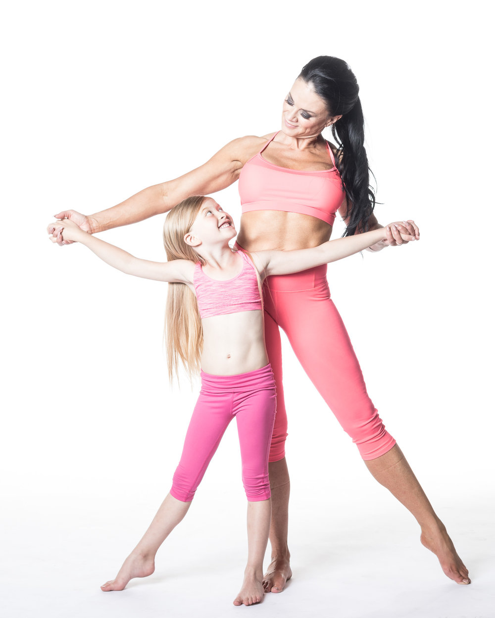 Cute picture of mother and daughter in yoga clothes.