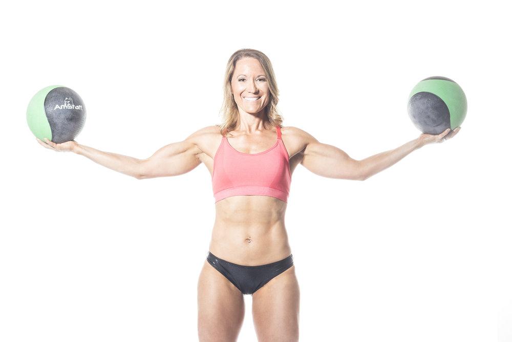 woman-holding-medicine-balls