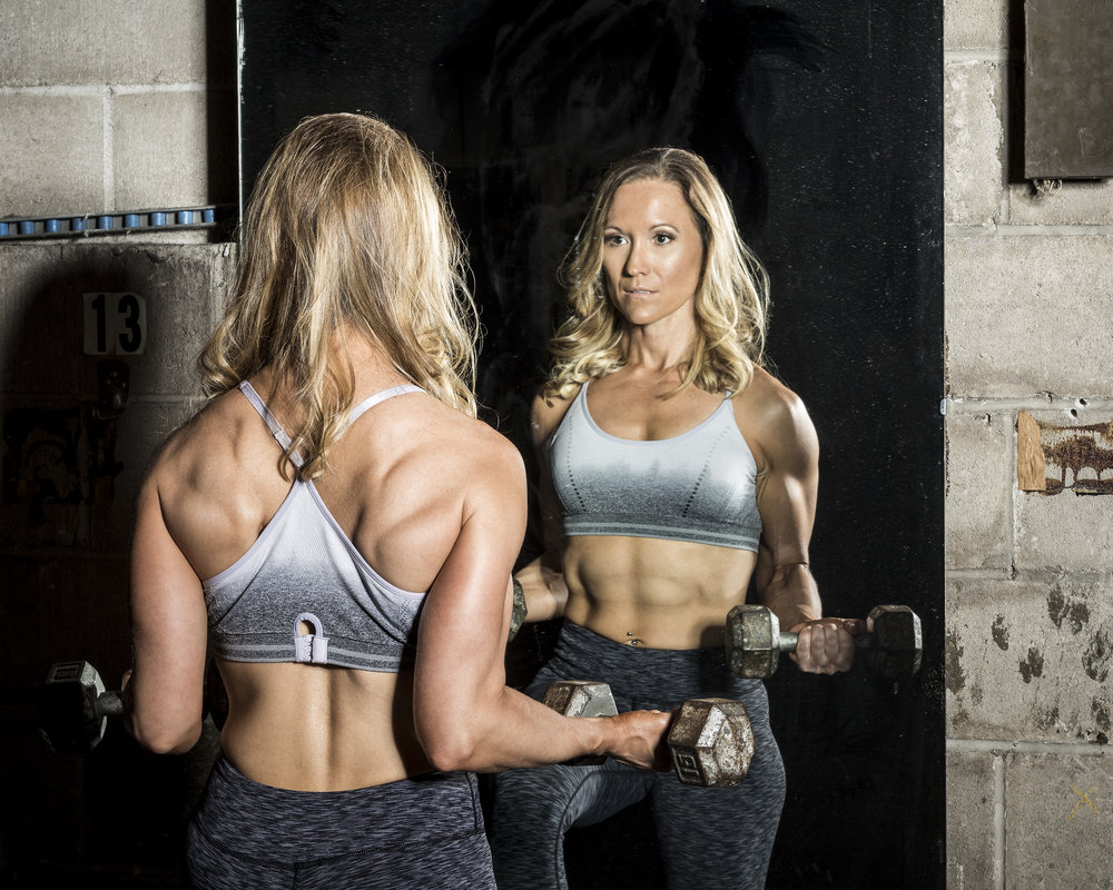 woman-with-dumbbells-in-mirror