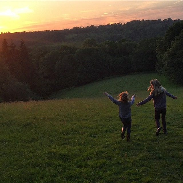 Go Wild Forest School Children running at sunset.JPG