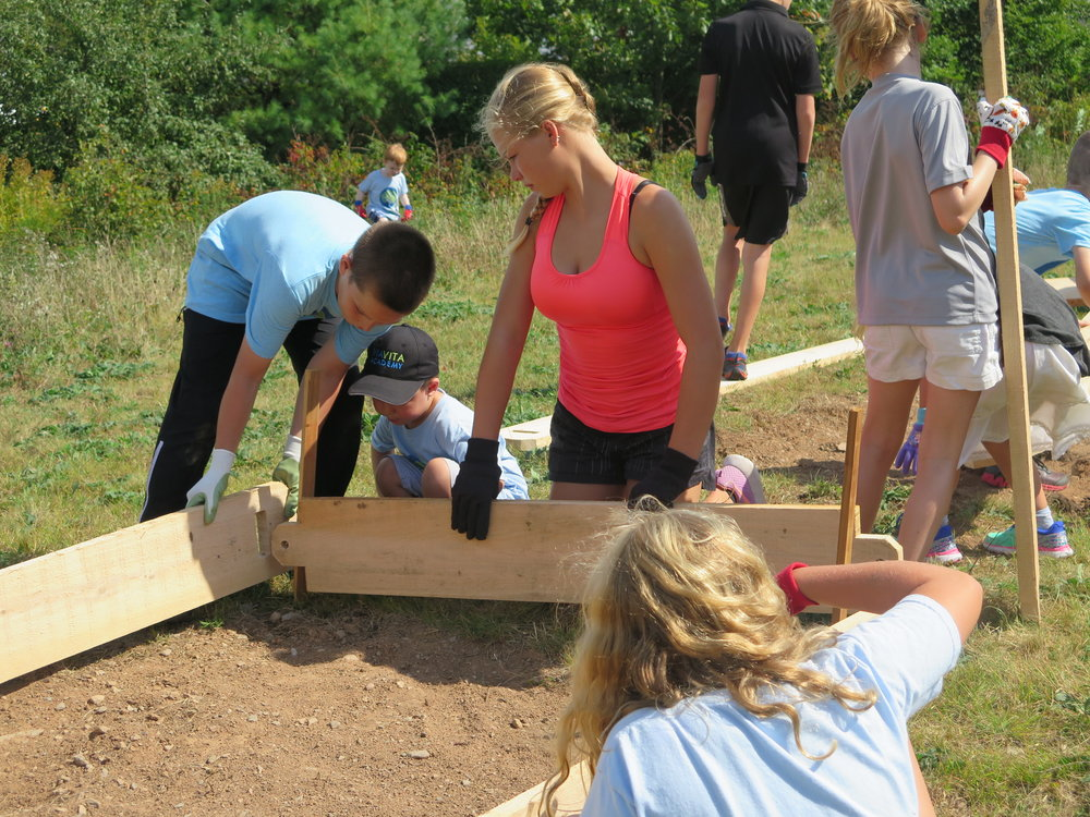 Installing raised beds with our favorite young gardeners at Via Vita Academy.