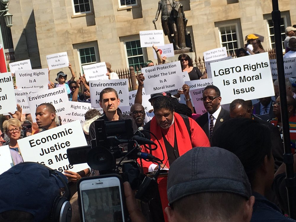 "Rev. Dr. William J. Barber addresses clergy, activists, advocates, and people impacted by extremism, during the Sept. 12 ""Higher Ground Moral Day of Action"" march at the Capitol building in Raleigh, NC."