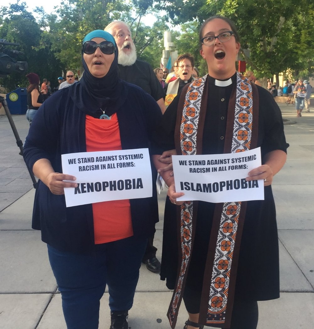 Samia Assed  and Rev. Dr. Liz Theoharis marching against systemic racism.