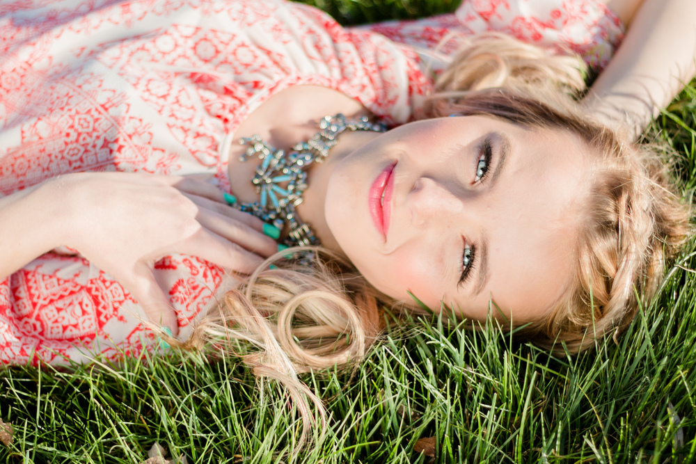 Summer senior pictures laying in grass