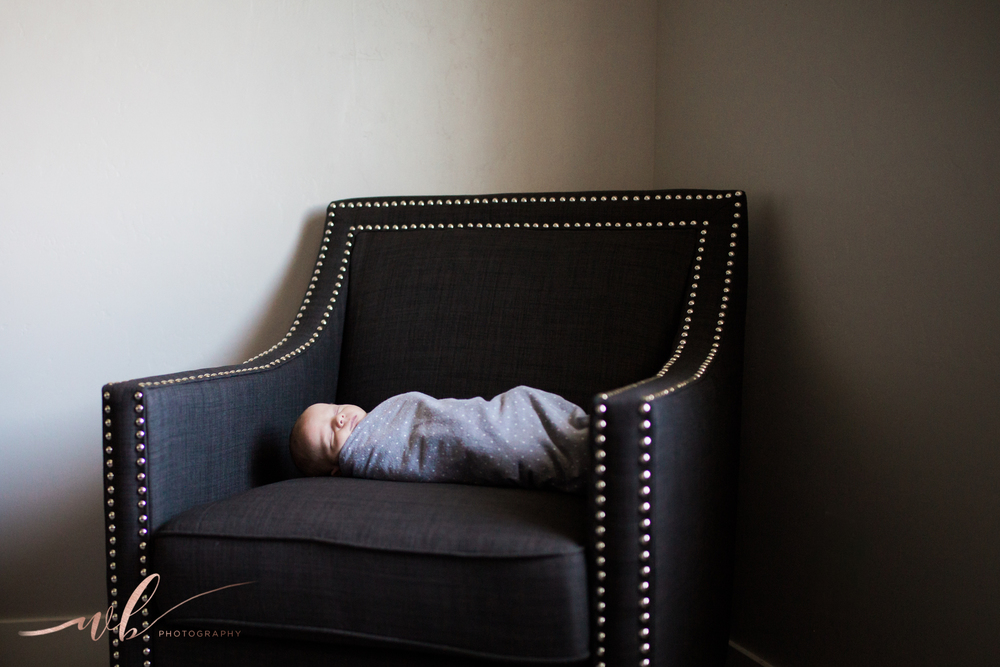 newborn in chair