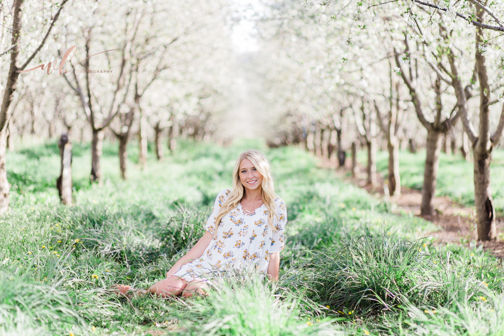 high school senior pictures in an orchard in Utah