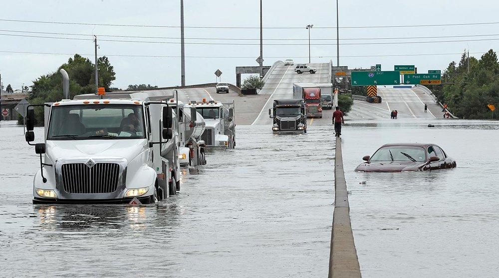 harvey-hurricane-flood-trucks-highway.jpg