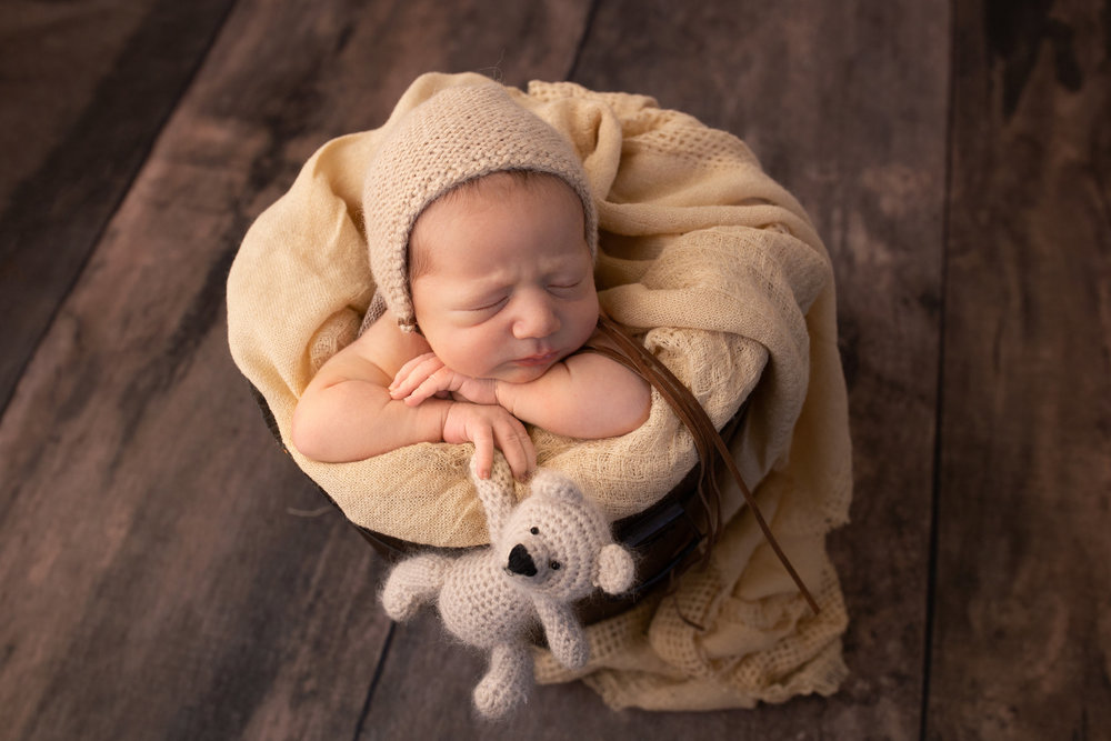 """- """"Kristen is SO talented! She was great with my baby girl. She definitely has a magic touch when it comes to soothing babies. Her studio has lots of adorable props and the photos turned out beautifully! You can't even find better newborn photos on Pinterest. Haha. Thank you again, Kristen!"""" - Nicole C"""