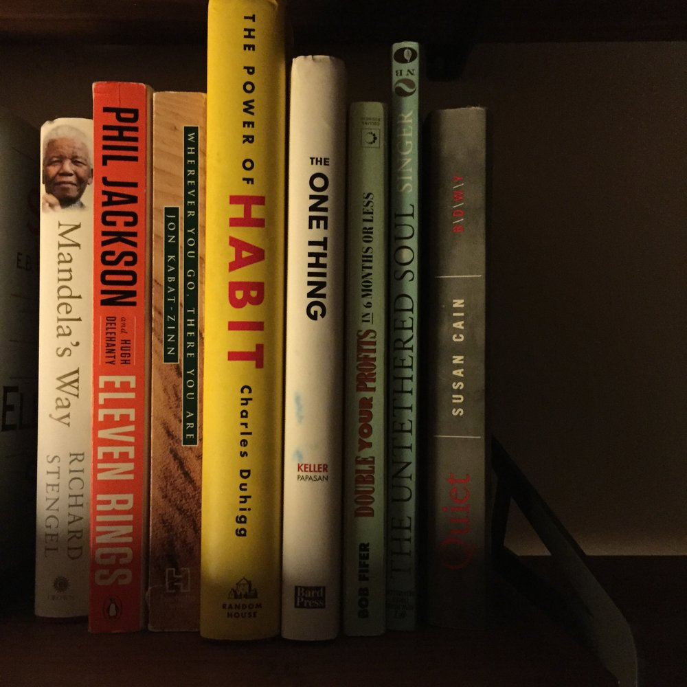 Eight books I love, with two on loan.