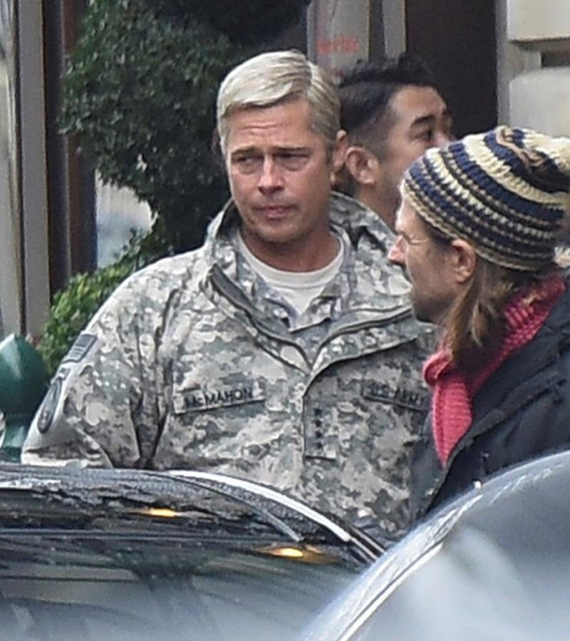 Brad Pitt and Ausralian filmmaker David Michôd discussing the scene; on set in London during the production of the Netflix original film 'War Machine , September, 2015.         The film will be released in theatres and on Netflix this fall, 2016.