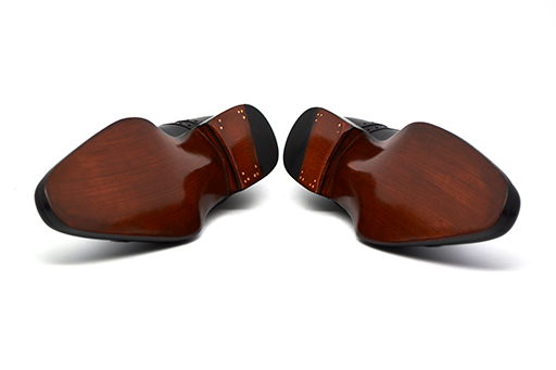 Cobbler Union's Italian leather soles, finished with their signature patina and beveled waist. Truly bespoke inspired.