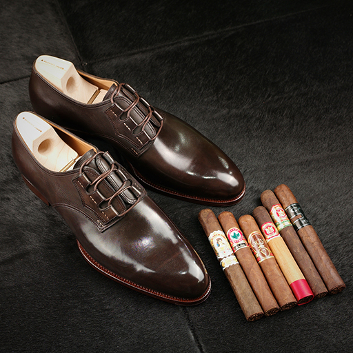 Some non-Cuban selects alongside a pair of derby shoes.
