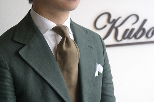 Kubo jacket, made from a very heavy Irish linen fabric from Spence Bryson. The tie featured is an ocher solid three fold untipped tie