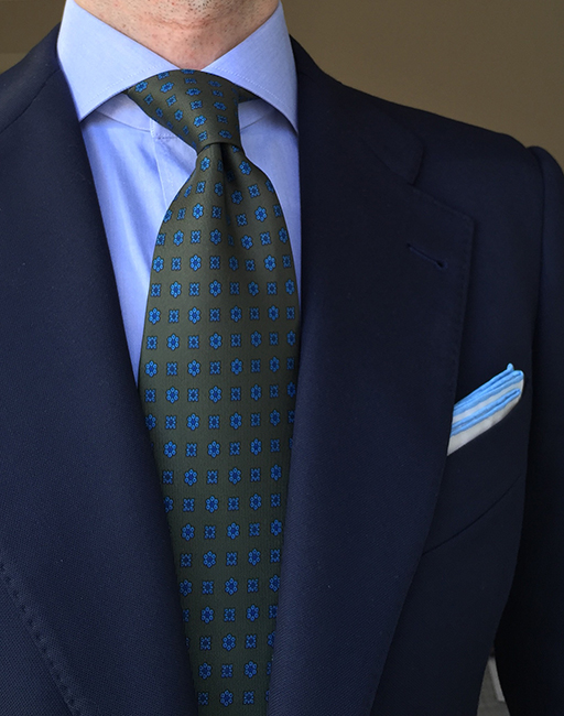 Navy blue and green patterned tie
