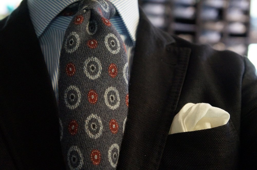 Andrew's Ties Sweden tie with white pocket square.