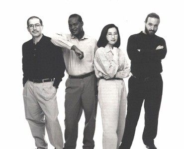 Four IBM programmers in the 1990's. Photo courtesy of www.ibm.com