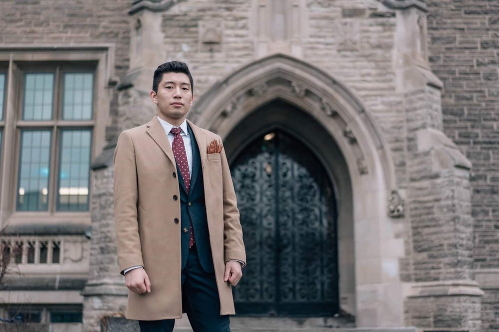 A camel topcoat worn by a young professional