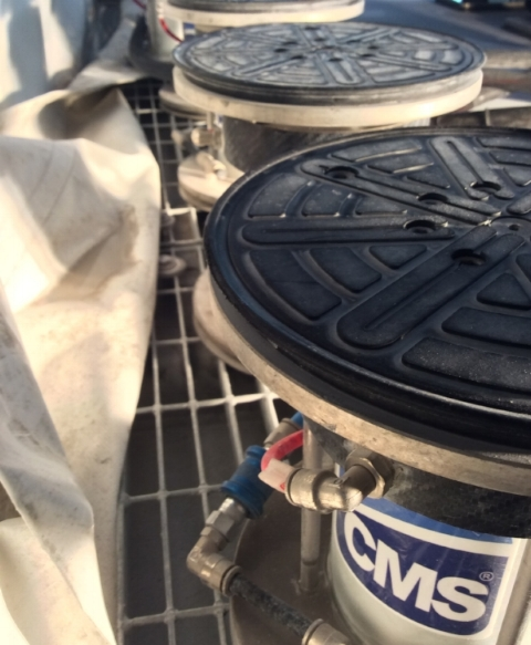 Slabs rest on hydraulic suction cups during processing