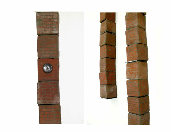 """Building Blocks"" (2008)<br>Cement, pigment, peepholes, steel brackets<br>Ea. brick 2 x 2 x 2 inches."