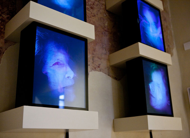 """Living Shrouds"" (installation view) (2010) LCD screen, wireless modem, aluminum frame, glass. 16 x 13 x 5.5 in."