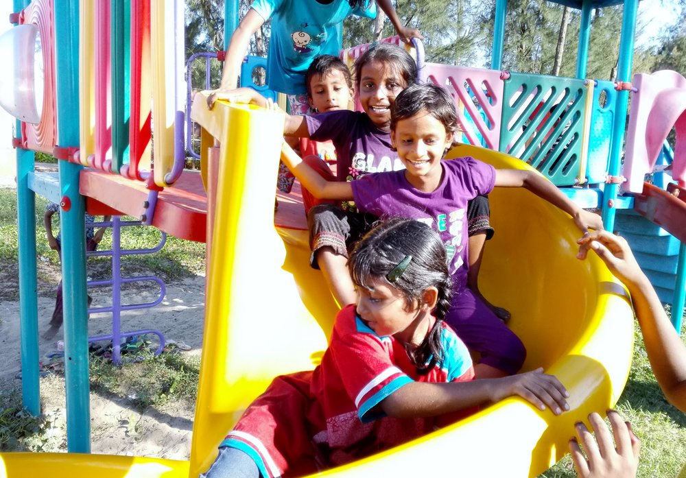 The Bloom Center children enjoying the park after some playtime at the beach