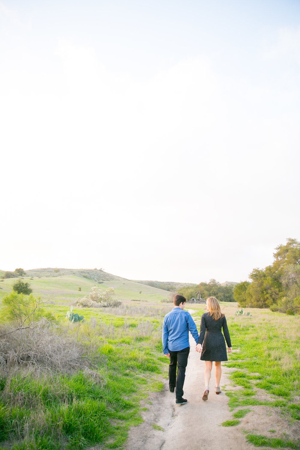 "<a href=""/megan-jon""><span style=""color:white;"">Megan & Jon</span> →<strong>Engagement Session</strong></a>"