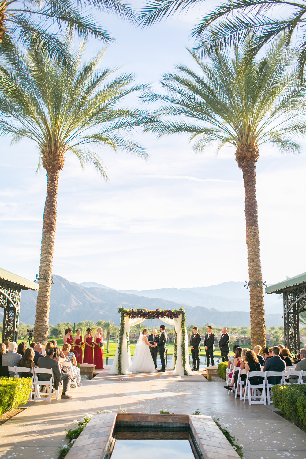 "<a href=""/kelsey-chris""><span style=""color:white;""> Kelsey & Chris →<strong>Palm Springs Wedding <br> Toscana Country Club </strong></a>"