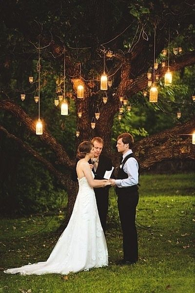 www.kaylabellevents.com, hanging lantens, wedding ceremony decor, rustic weddings, lantern hanging from tree decor