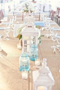 www.kaylabellevents.com, beach weddings, beach lantern centerpiece, white lantern centerpieces, blue mason jar  centerpieces, long wedding table decor