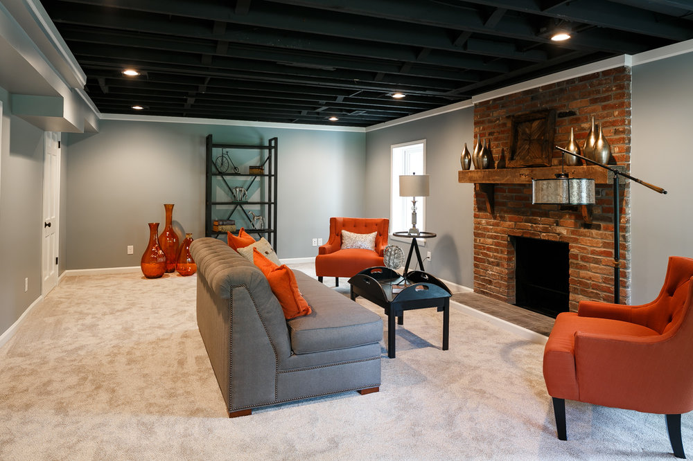 Basement living room with working woodturning fireplace