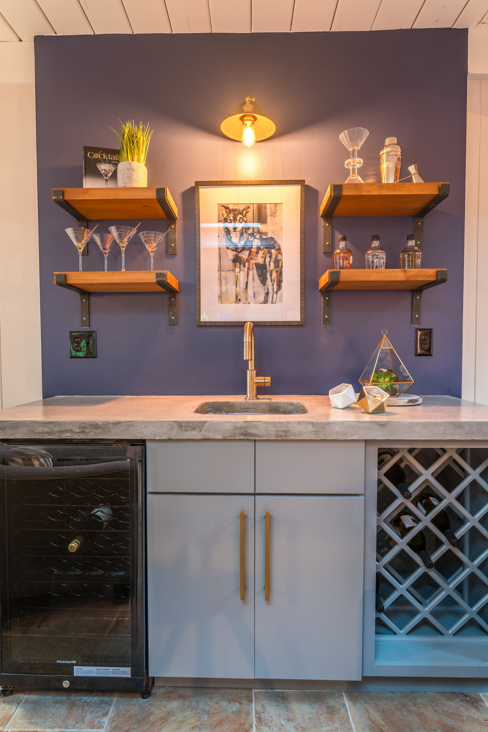 Custom wet bar with beverage fridge and wine rack